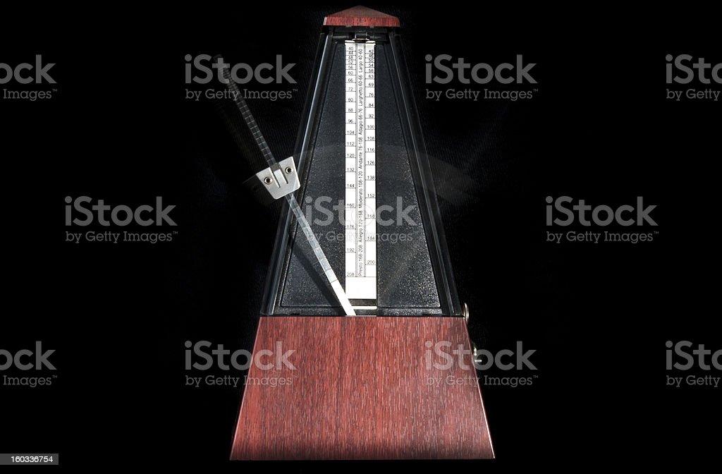 Wooden metronome stock photo