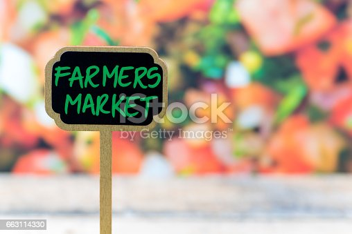 923869178 istock photo Wooden mini blackboard label over vegetable salad background 663114330