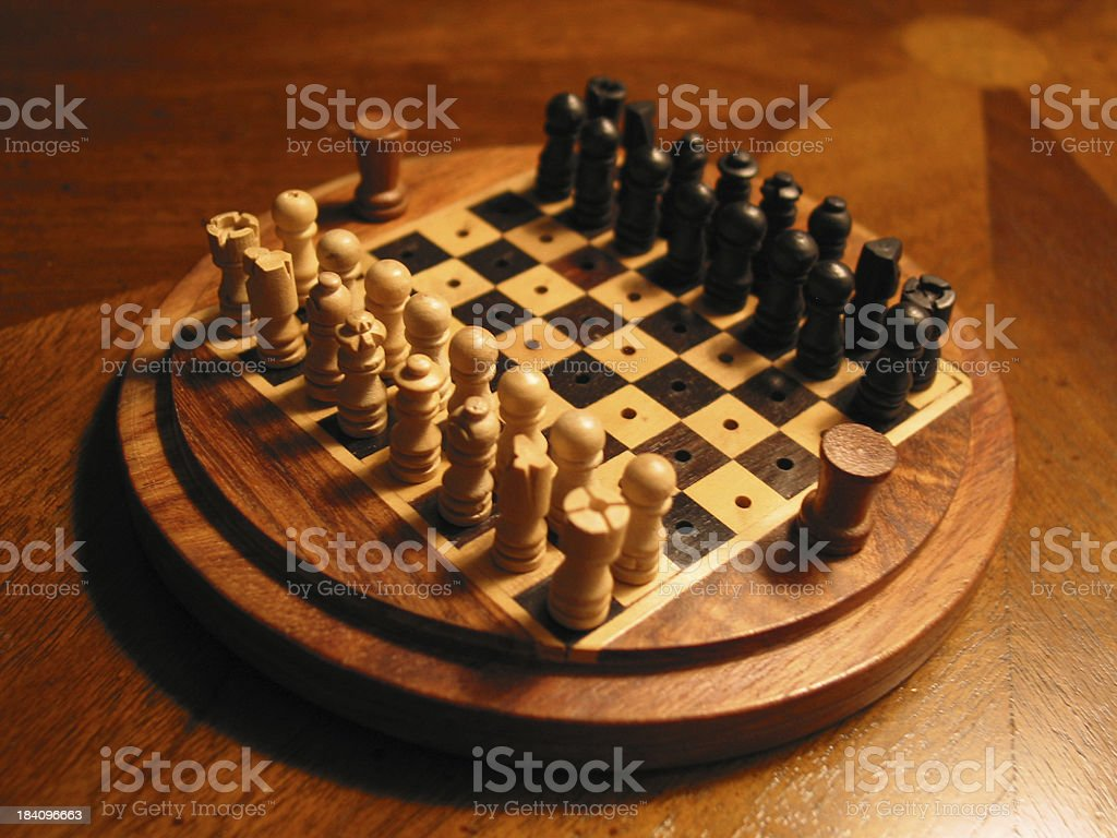 Wooden Miniature Chess Set on Polished Wood royalty-free stock photo