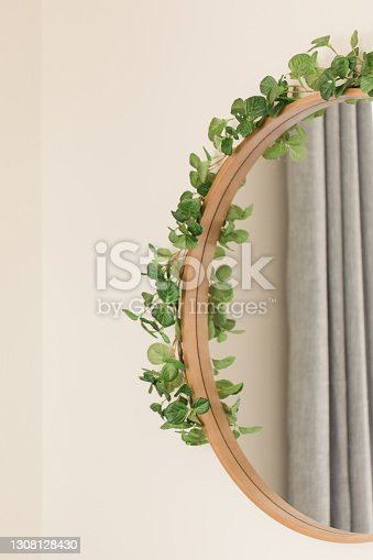 Wooden Mirror on a Wall with Ivy On It