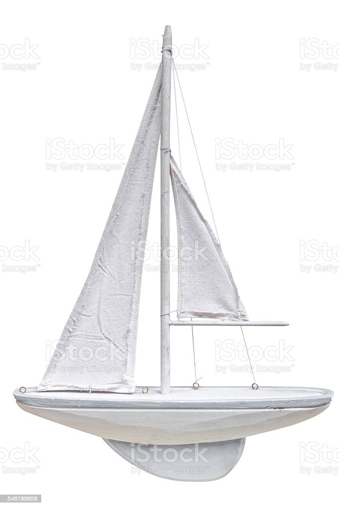 wooden model of sailing yacht isolated on a white background stock photo