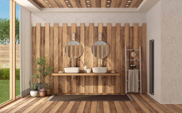 Wooden modern bathroom with double washbasin stock photo