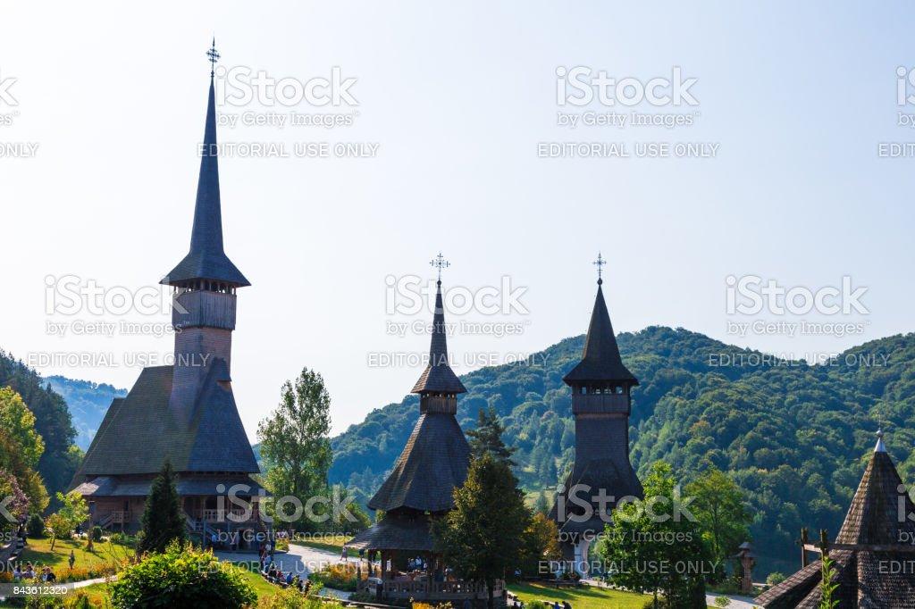Wooden monastery and church at Barsana, Maramures, Romania stock photo