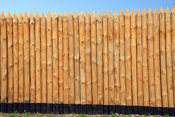 wooden paling - palisade boundary stock photos and pictures