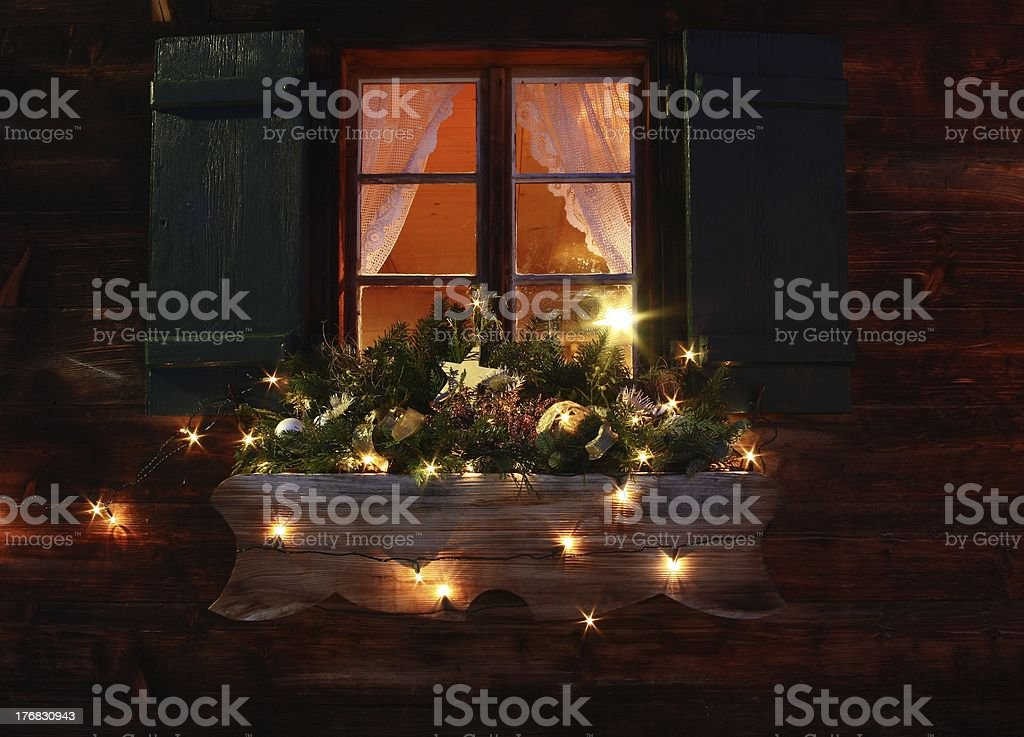 Wooden mountain hut in christmas time stock photo