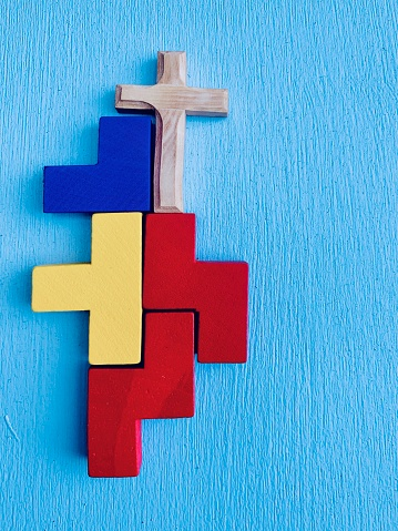 istock Wooden multi colored blocks with crucifix 1159217200