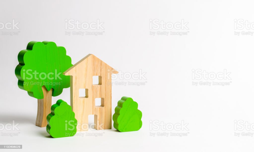 Wooden multi-storey building surrounded by bushes and trees. Urbanism and urban landscaping. Acquisition of affordable housing in a mortgage. Accommodation for young families. Apartments for rent stock photo