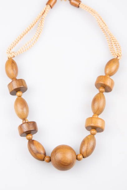wooden necklace in wood beads fashion brown in white background stock photo