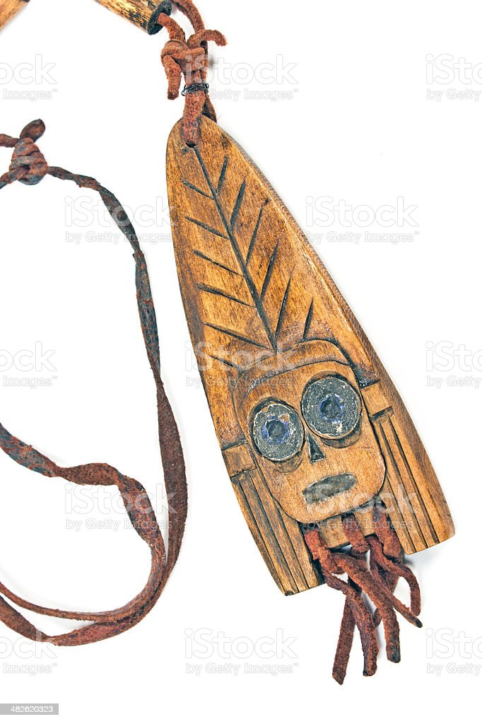 Wooden necklace with pendant of african woman on white royalty-free stock photo