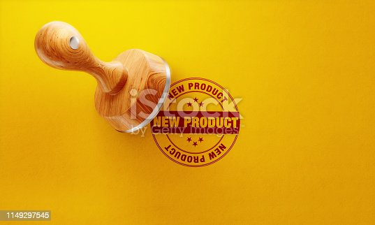 istock Wooden New Product Stamp On Yellow Background 1149297545