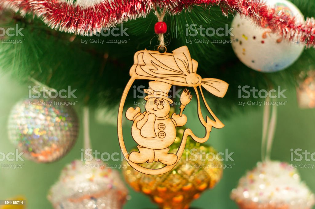 Wooden new year christmas toy on a fir tree stock photo