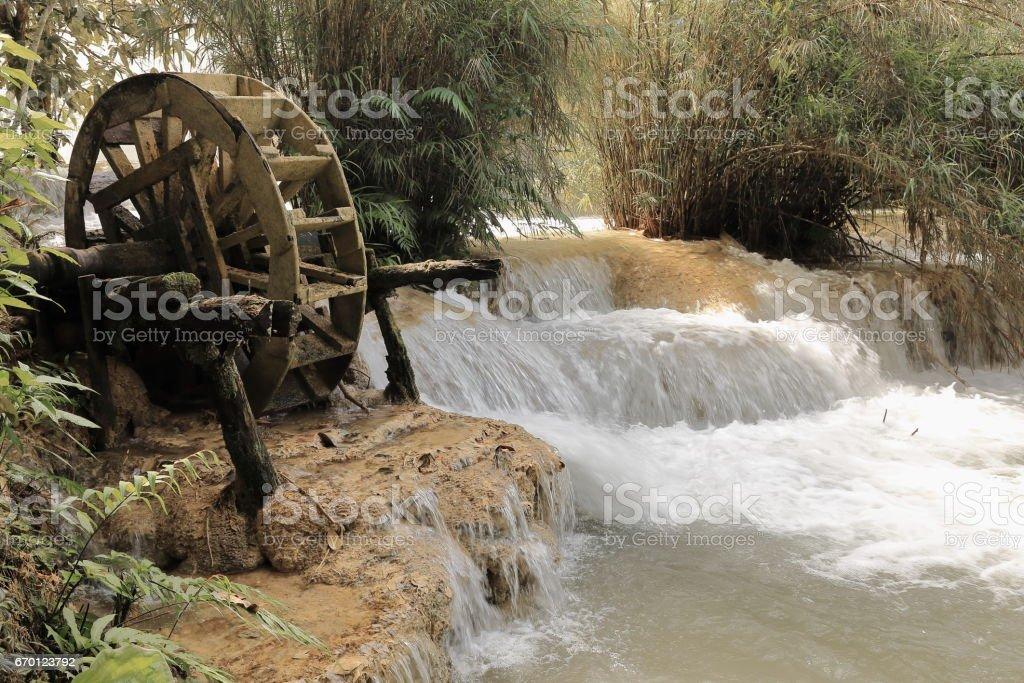 Wooden noria remains-way to TatKuangSi-Deer Dig falls. Luang Prabang-Laos. 4158 stock photo