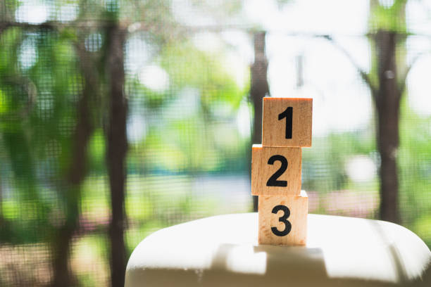 wooden number on sunlight - terceira imagens e fotografias de stock