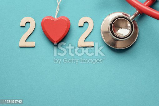 istock 2020 wooden number with red stethoscope. Happy New Year for heart health and medical concept, life insurance business 1173494742