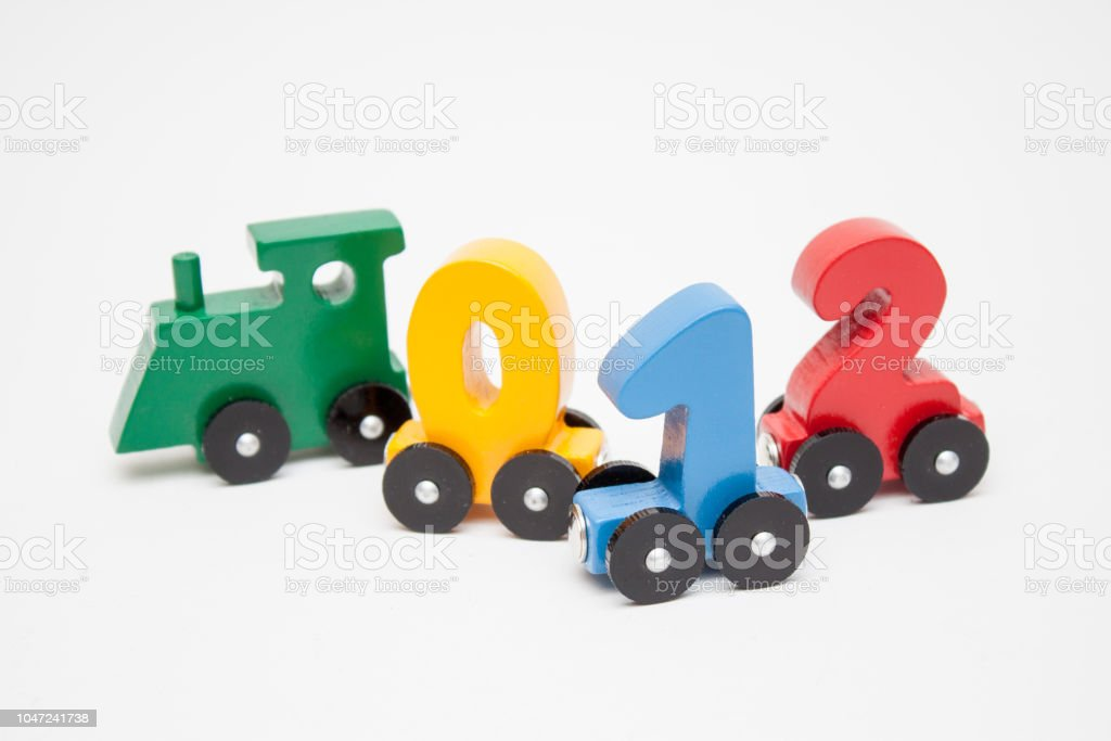 Wooden Numbers 0124 Letters Train Cars Alphabet Bright Colors Of Red Yellow Green On A White Background Early Childhood Education Learning To Count Preschool And Kids Game Concept Stock Photo Download