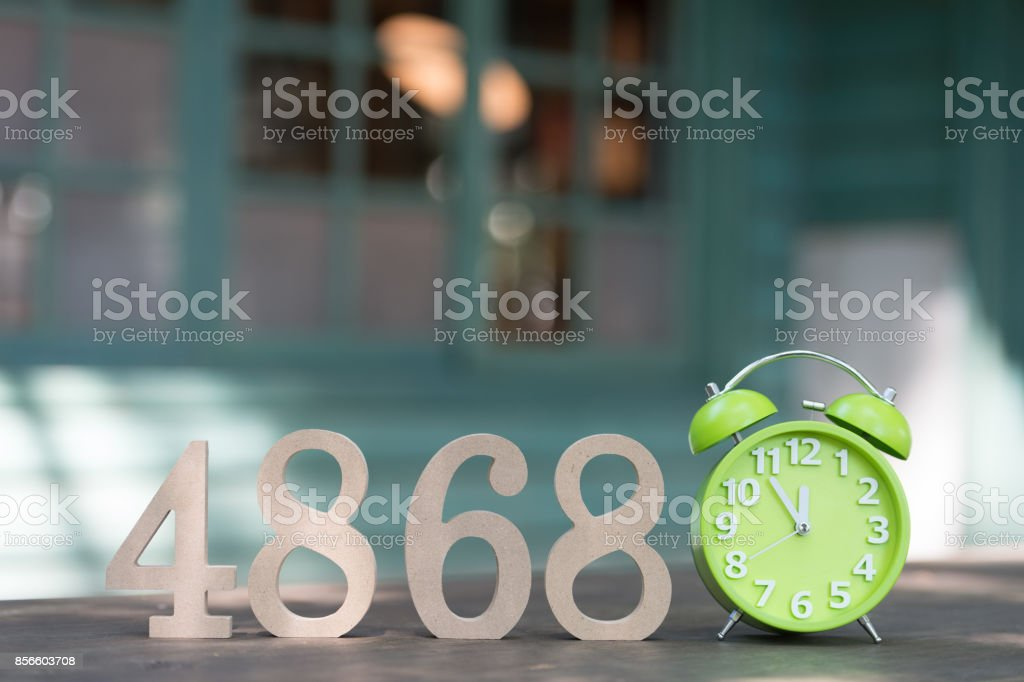 Wooden numbers forming the number 4868, Retro alarm clock with five...