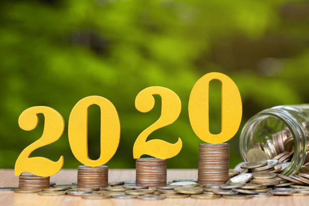 2020 wooden numbers on coins stacked showing financial growth, Saving money on new year concept