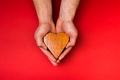 wooden oak heart in hands , valentines day