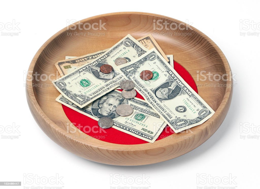 Wooden offering plate containing bills and coins stock photo