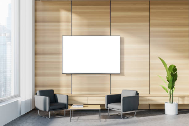 Wooden office waiting room with armchairs and TV stock photo
