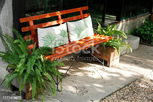 647209792 istock photo wooden old bench in the cafe garden 1171478622