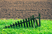 istock Wooden old fence in the summer field 1248479913