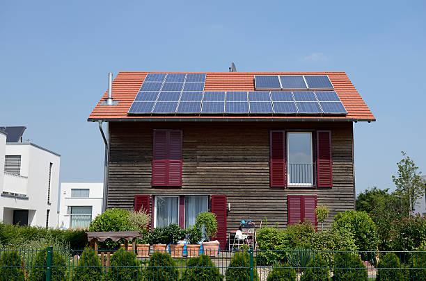 wooden one family house with solar panels on the roof - solar panel bildbanksfoton och bilder