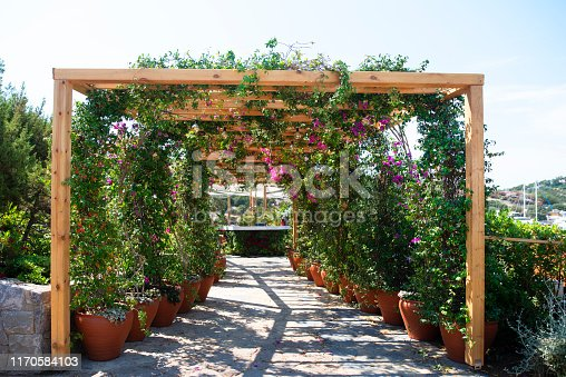 Wooden open pavilion with flowers