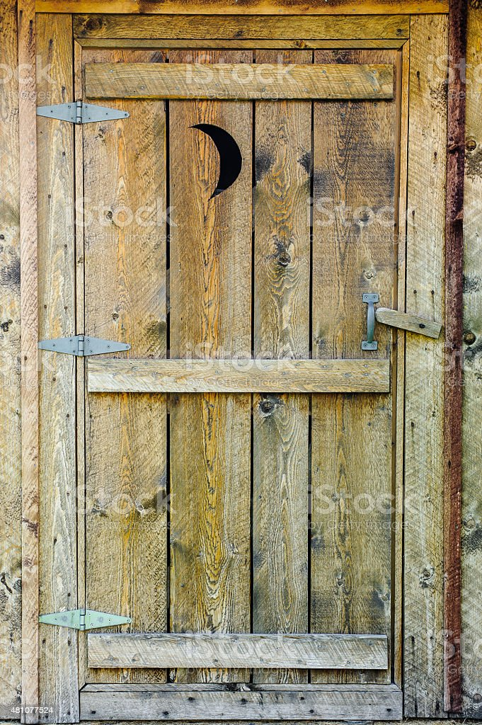 Wooden Outhouse Door made of rough cut lumber stock photo