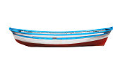 istock Wooden painted boat isolated on a white background 700470292