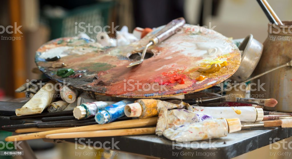 Wooden palette and artist's materials in an art studio, Italy stock photo