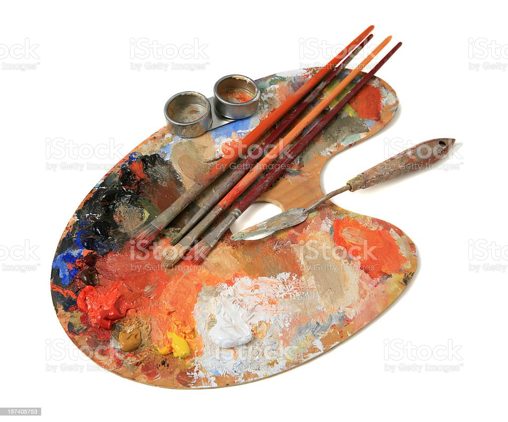 Wooden palette with paintbrushes and oil paint on white stock photo