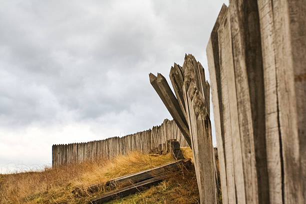 wooden palisade - palisade boundary stock photos and pictures