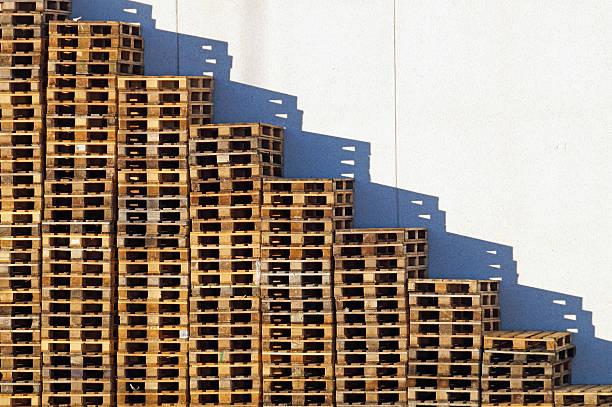wooden pallet overlap in warehouse stock photo