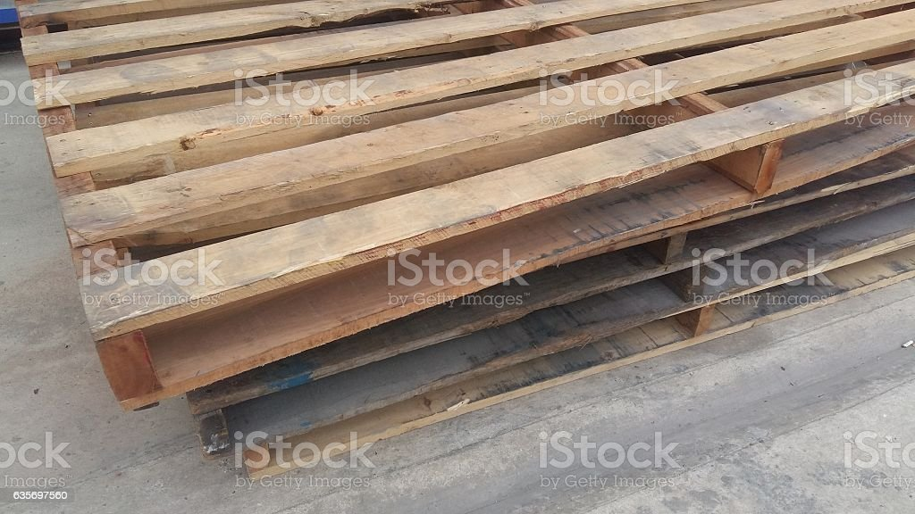 Wooden pallets are stacked for use royalty-free stock photo