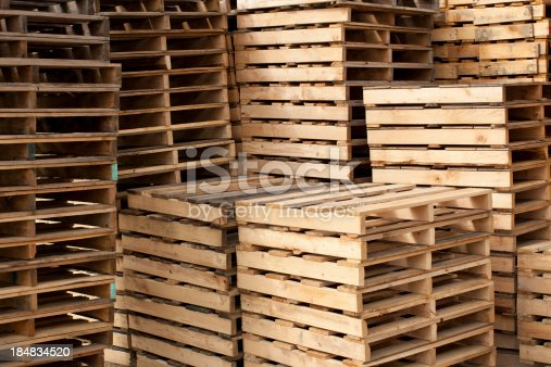 Wood shipping pallets stacked high