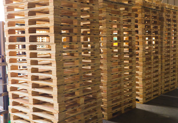 wooden pallets stack at the freight cargo warehouse for transportation and logistics industrial - pallet foto e immagini stock