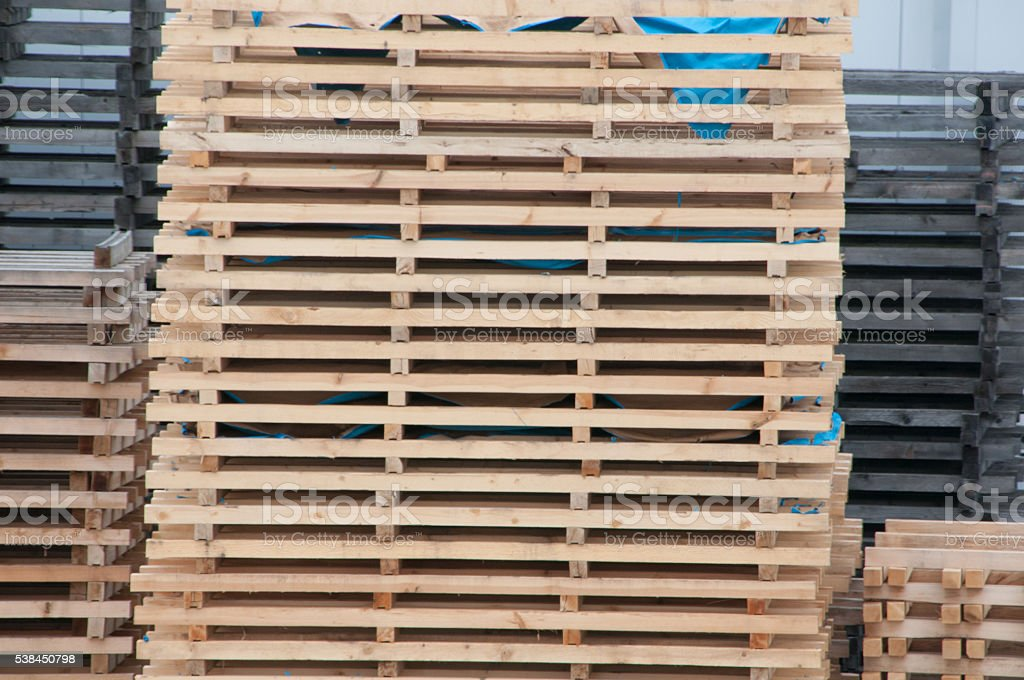 Wooden pallets stacked, stock photo