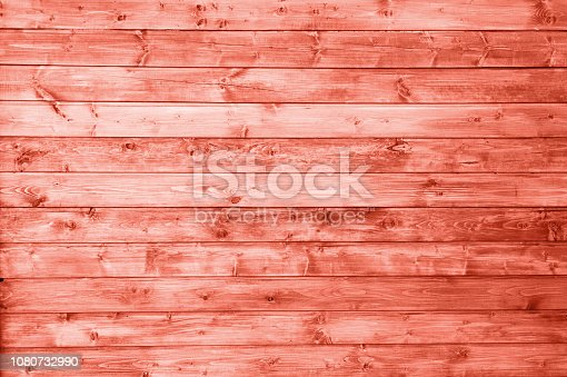 istock wooden pannels texture colored in color of year 2019 Living Coral background. Bright Macro color 16-1546 background. Retro gate background. 1080732990