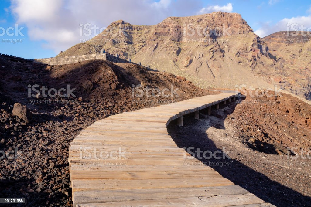 Wooden path on the volcanic coast of Tenerife royalty-free stock photo