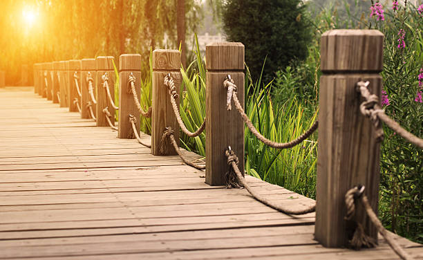 wooden path with railing stock photo