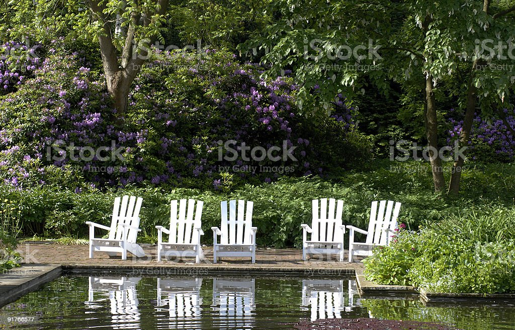 Wooden patio chairs in springtime park royalty-free stock photo