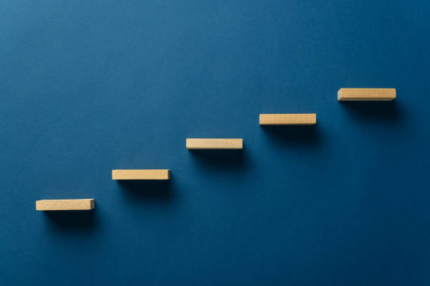 Wooden pegs forming a stairway stock photo