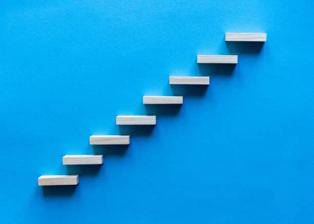 Wooden pegs forming a stairway. Wooden stairs offering promotion of the business. Business promotion stairs to heaven. stairs to the blue sky. Wooden stairs. Business start up. Promotion and elevation stock photo