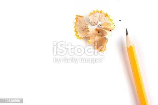 Wooden pencil isolated on a white background with shavings