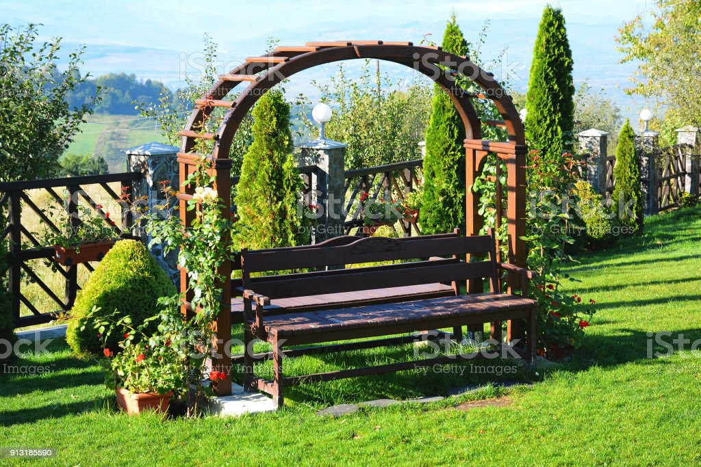 Fine Wooden Pergola With White Roses Pelargonium And Bench In The Forskolin Free Trial Chair Design Images Forskolin Free Trialorg