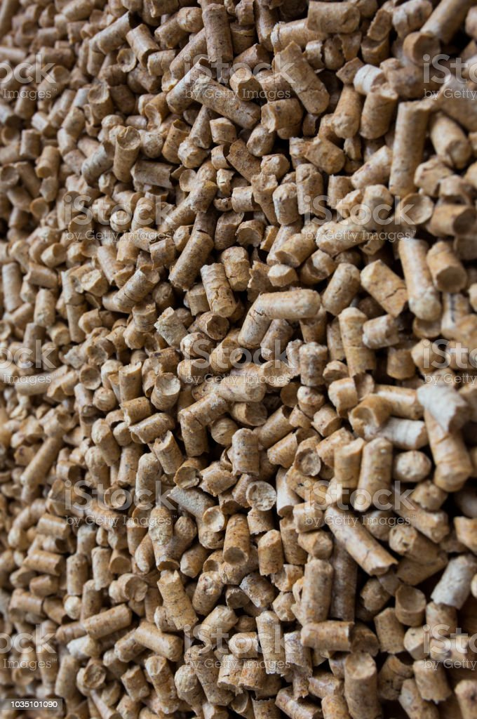 Wooden pet bedding background. Wood pellets texture.
