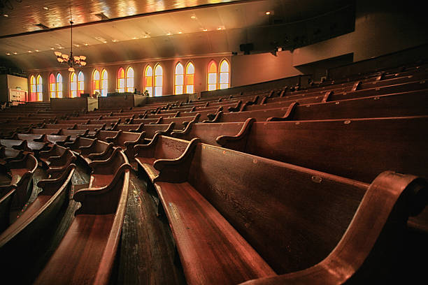 Wooden pews Wooden pews in the Ryman Auditorium the Mother Church of Country Music in Nashville Tennessee pew stock pictures, royalty-free photos & images