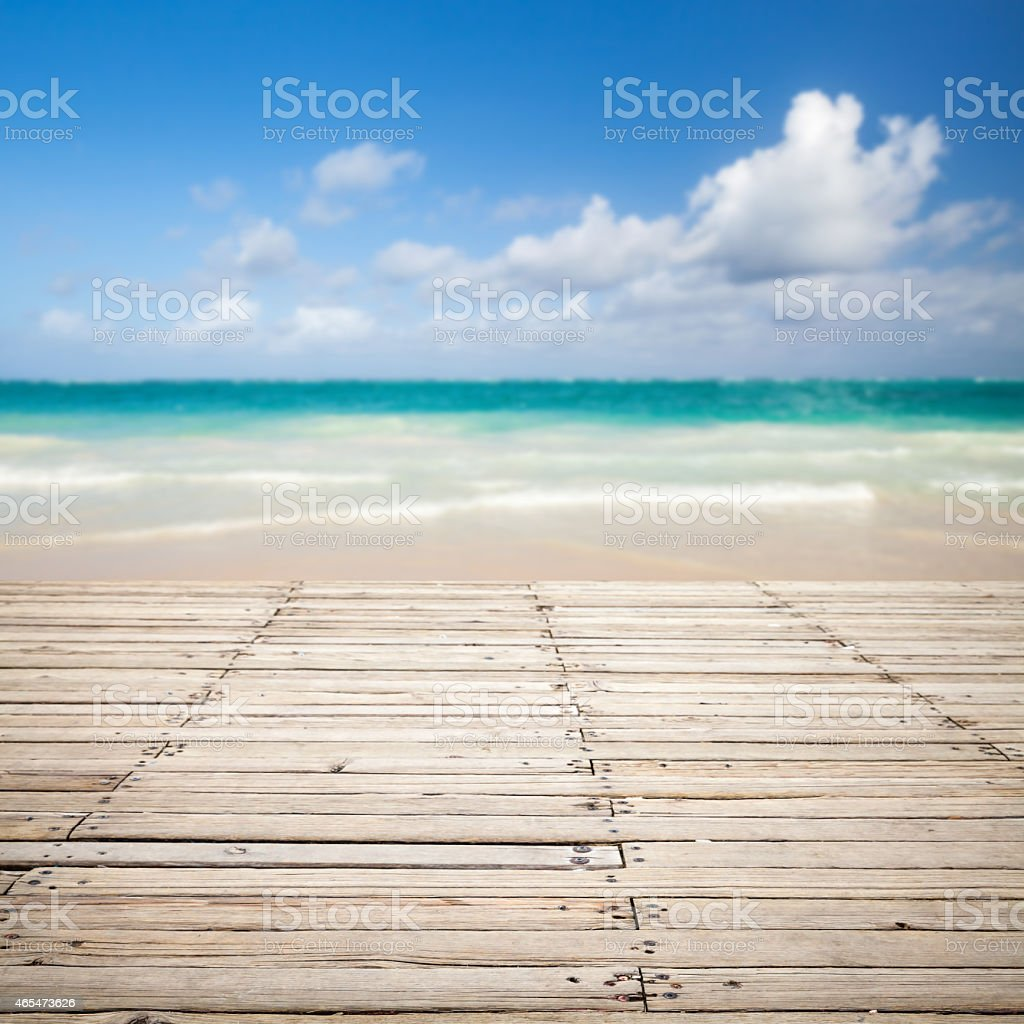 Wooden pier and blurred sea landscape on a background stock photo