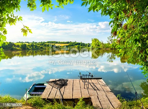 1094918172 istock photo Wooden pier and river 1180788320
